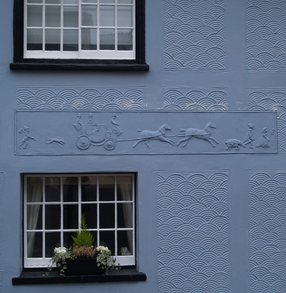 Pargetting of a stage coach, on the side of a house in  Gold Street, Saffron Walden